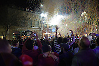 6th Street party goers toast the New Year's Eve Countdown and Ball Drop in downtown Austin, Texas