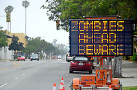"A prankster(s)  hacked into this electronic road sign on Colorado Ave. and replaced the real warnings with ""ZOMBIES AHEAD BEWARE"" on Saturday, July 14, 2012."
