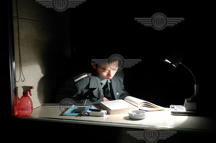 A building security guard studying while on night duty.