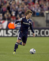 New England Revolution forward Zack Schilawski (15) brings the ball forward. In a Major League Soccer (MLS) match, Real Salt Lake defeated the New England Revolution, 2-0, at Gillette Stadium on April 9, 2011.