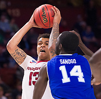 NWA Democrat-Gazette/J.T. WAMPLER Arkansas' Duston Thomas brings down a rebound in front of Seton Hall's Ismael Sanogo Friday Mar. 17, 2017 during the first round of the NCAA Tournament at the Bon Secours Wellness Arena in Greenville, South Carolina. Arkansas won 77-71 and will advance to the second round, playing Sunday at the same location.