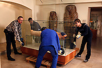 "GEORGES LABIT MUSEUM, TOULOUSE, FRANCE - MARCH 03 - EXCLUSIVE : A general view of the Egyptian mummy encased in a sarcophagus moved by warehousemen that are about to take the cover off on March 3, 2009 in the Georges Labit Museum, Toulouse, France. The Egyptian mummy arrived in Toulouse in 1849, encased in a sarcophagus labelled ""In-Imen"" from the 7th or 8th century BC. It is preserved at the Labit Museum since 1949. The mummy has been the subject of a very rare tissue sampling operation to determine its datation.  (Photo by Manuel Cohen)"