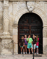 Young grade school girls on a field trip to the Alamo in Texas. Image taken at the front entrance to this historic landmark, with the girls in a mischievous mood.