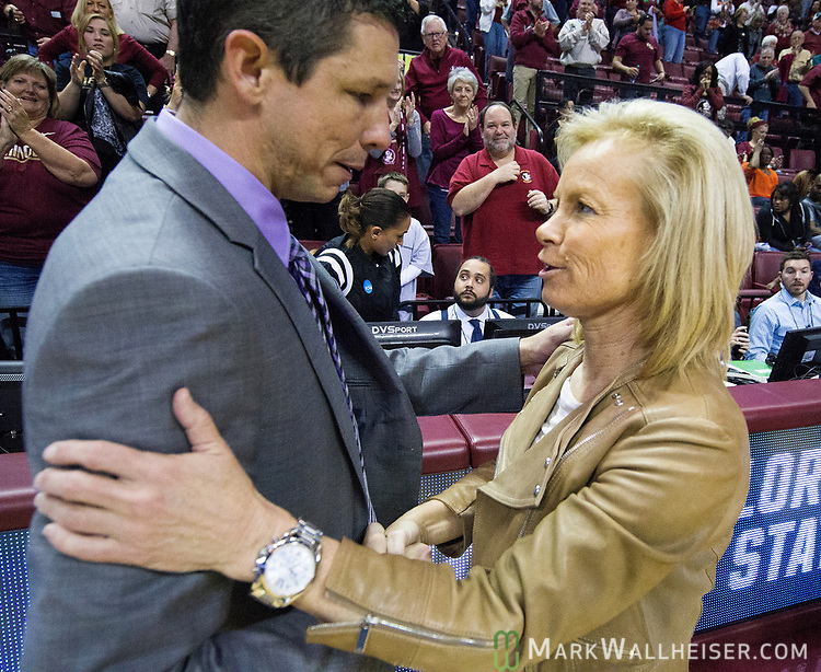 Western Illinois  head coach JD Gravina  and Florida State head coach Sue Semrau meet after a first-round game of the NCAA women's college basketball tournament in Tallahassee, Fla., Friday, March 17, 2017. Florida State defeated Westeren Illinois 87-66. (AP Photo/Mark Wallheiser)