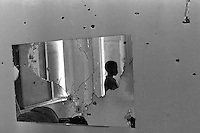 Oakland Police-Black Panther shootout: Bullet holes in the walls and mirror in the home of Mrs. Nellie Pierre at 1218 28th st. In Oakland, where Eldridge Cleaver and Bobby Hutton were barricaded. Cleaver and Hutton eventuality came out, Cleaver was captured and Bobby Hutton was shot and killed by police. <br />