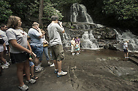 Tourists taking pictures at Laurel falls in Tennessee part of The grate Smoky Mountains
