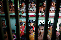 Myanmar Rohingya people gather at a local mosque before the Friday prayers in a village of Gollyadeil north of the town of Sittwe May 18, 2012. REUTERS/Damir Sagolj (MYANMAR)