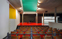 Theatre of the Maison du Bresil or Brazil House, designed by Le Corbusier (Charles-Edouard Jeanneret, 1887-1965) and Lucio Costa, 1902-1998, and inaugurated in 1954, with areas of bold painted colour, in the Cite Internationale Universitaire de Paris, in the 14th arrondissement of Paris, France. The building is listed as a historic monument and was renovated 1999-2000 by Bernard Bauchet and Hubert Rio. The CIUP or Cite U was founded in 1925 after the First World War by Andre Honnorat and Emile Deutsch de la Meurthe to create a place of cooperation and peace amongst students and researchers from around the world. It consists of 5,800 rooms in 40 residences, accepting another 12,000 student residents each year. Picture by Manuel Cohen. L'autorisation de reproduire cette œuvre doit etre demandee aupres de l'ADAGP/Permission to reproduce this work of art must be obtained from DACS.