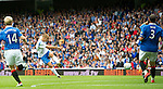 Rangers v St Johnstone....28.08.10  .Danny Grainger fires the ball past Allan McGregor to gives saints a 1-0 lead.Picture by Graeme Hart..Copyright Perthshire Picture Agency.Tel: 01738 623350  Mobile: 07990 594431