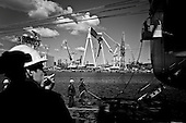 Gdynia 14 May 2009 Poland.<br /> The Gdynia Shipyard.<br /> The Polish shipyard industry is in a deep crisis. The Gdansk and Szczecin shipyards are under the threat of liquidation. The battle between the Polish government, creditors and European Union rages on. Spyard workers live under immense pressure of dissmissals. They are completely unsure of their future; they leave, search for work in England, Irland, Norway. During last two months over 25 % of workers left the Szczecin shipyard. The trade union Solidarnosc, with its cradle shipyard in Gdansk fought for free Poland 27 years ago. Today it fights for the survival of the shipyard.It organizes manifestations. In the 70's ansd 80's nearly 20 thousand people worked in the shipyard. Today only 3 thousand are left and a ghast feeling of emptiness in most of the shipyard's sectors.<br /> (Photo by Filip Cwik / Napo Images for Newsweek Poland )<br /> <br /> Gdynia 14 maj 2009 Polska.<br /> Polski przemysl stoczniowy pograzony jest w glebokim kryzysie. Stoczniom z Gdanska i Szczecina grozi likwidacja. Gra sie toczy pomiedzy Polskim rzadem, wierzycielami a Unia Europejska. Stoczniowcom groza zwolnienia grupowe. Nie sa pewni przyszlosci; odchodza, wyjezdzaja do Anglii, Irlandii, Norwegii. W ciagu dwoch miesiecy ze stoczni Szczecinskiej zwolnilo sie 25% pracownikow. Zwiazek zawodowy Solidarnosc, ktorej kolebka jest zaklad w Gdansku 27 lat temu walczyl o wolna Polske, dzis walczy o utrzymanie zakladu pracy.<br /> <br /> (fot. Filip Cwik / Napo Images dla Newsweek Polska )