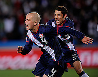 Michael Bradley (left) of USA celebrates his goal with Herculez Gomez (right) 2-2. USA vs Slovenia in the 2010 FIFA World Cup at Ellis Park in Johannesburg, South Africa on June 18th, 2010.