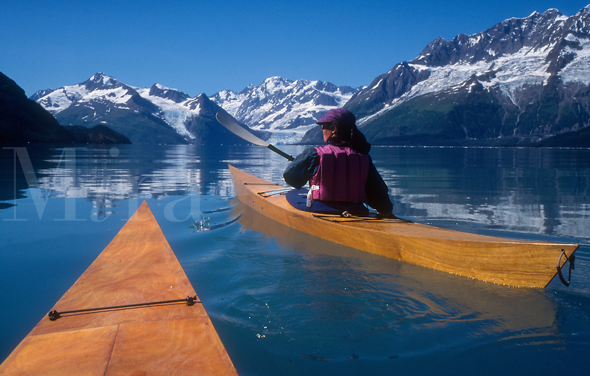 Kayakers paddle up Port Wells toward Harriman Fjord in Prince William Sound.
