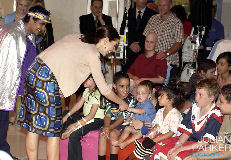 Crown Prince Frederik & Crown Princess Mary of Denmark 2-week visit to Australia. Mary visited the Australian Cancer Research Foundation at Westmead Hospital, near Sydney, where she read a Hans Christian Andersen story to children..