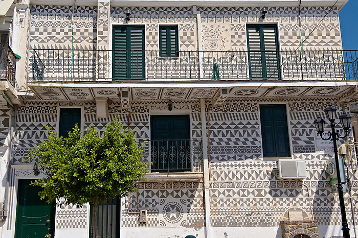 Xysta on the houses of Pygri, geometic patterned decorations in black and white that adorn the houses of the Mastic Villages of southern Chios dating back to the period Genoses rule. Mastichochoria area of Chios Island, Greece.