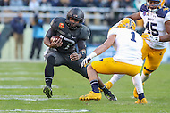 Baltimore, MD - December 10, 2016: Army Black Knights quarterback Ahmad Bradshaw (17) avoids Navy Midshipmen safety Alohi Gilman (1) tackle during game between Army and Navy at  M&T Bank Stadium in Baltimore, MD.   (Photo by Elliott Brown/Media Images International)
