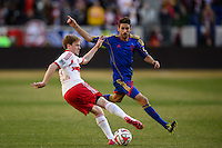 Dax McCarty (11) of the New York Red Bulls plays the ball in front of Jose Mari (6) of the Colorado Rapids. The New York Red Bulls and the Colorado Rapids played to a 1-1 tie during a Major League Soccer (MLS) match at Red Bull Arena in Harrison, NJ, on March 15, 2014.