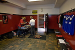 Staff in the club shop (a converted former dressing room) at Seaview Park, Belfast prepare souvenirs for sale before Northern Irish club Crusaders take on Fulham in a UEFA Europa League 2nd qualifying round, fist leg match. The visitors from England won by 3 goals to 1 before a crowd of 3011.