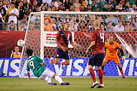 Michael Orozco Fiscal (5)  of the United States goes over the tackle of Omar Arellano (9)  of Mexico. The men's national teams of the United States (USA) and Mexico (MEX) played to a 1-1 tie during an international friendly at Lincoln Financial Field in Philadelphia, PA, on August 10, 2011.