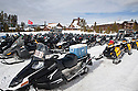 WY00445-00...WYOMING - Snow mobiles at Old Faithful in Yellowstone National Park.