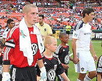 Troy Perkins #23 of D.C. United and Omar Gonzalez #4 of the Los Angeles Galaxy enter the field during an MLS match at RFK Stadium on July 18 2010, in Washington D.C. Galaxy won 2-1.