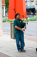 A bagpiper performs in downtown San Antonio, Texas near the Riverwalk.