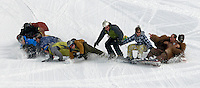 NEWS&amp;GUIDE PHOTO/PRICE CHAMBERS.They all fall down together as Eric Sweet leads the first ever descent of a ten-man snowboard on Wednesday at Jackson Hole Mountain Resort. No April Fool's joke, the ten men are all Jewish and hope to qualify for the Guiness Book of World Records. Sweet used a handheld GPS to measure the distance of their longest run at 215 feet. The board is assembled on the slope with wing nuts after each rider brings his piece up the chairlift.