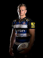 Chris Cook poses for a portrait in the 2015/16 home kit during a Bath Rugby photocall on September 8, 2015 at Farleigh House in Bath, England. Photo by: Patrick Khachfe / Onside Images