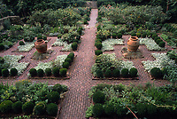 Formal double mirrored perennial garden with red brick pathways, symmetrical design landscaping, quadrants, round balls of boxwood yews, Cross Estate, Morristown, NJ