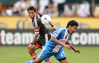 D.C. United midfielder Andy Najar (14) heads the ball from Philadelphia Union defender Sheanon Williams (25) D.C. United tied The Philadelphia Union 1-1 at RFK Stadium, Saturday August 19, 2012.