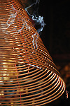 Bao-jhong Yi-min Temple, Kaohsiung -- Wafts of smoke from an incense coil under the temple roof structure.