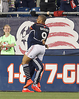 New England Revolution forward Charlie Davies (9) celebrates his goal with teammates. Foxborough, Massachusetts - August 16, 2014:  In a Major League Soccer (MLS) match, the New England Revolution (blue/white) tied Portland Timbers (green/white), 1-1,  at Gillette Stadium.