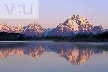 Mt. Moran in the Teton Range mirrored on the Snake River at sunrise, Grand Tetons National Park, Wyoming, Rocky Mountains.