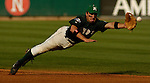 04 Jun 2006 Lincoln, NE Manhattan University's Ryan Marcoux can't quite reach a hit by Miami's Blake Tekotte during the third inning  during the NCAA Baseball Regionals at Hawks Field at Haymarket Park in Lincoln, Ne Sunday evening.(Chris Machian/Prairie Pixel Group)
