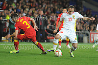 Cardiff City Stadium, Friday 11th Oct 2013. Ostoja Stjepanovic of Macedonia battles with Declan John of Wales during the Wales v Macedonia FIFA World Cup 2014 Qualifier match at Cardiff City Stadium, Cardiff, Friday 11th Oct 2014. All images are the copyright of Jeff Thomas Photography-07837 386244-www.jaypics.photoshelter.com