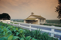 Amish school house, fresh tobbaco field in foreground.  Snake Hill road, Lancaster County, PA