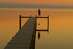 A fisherman enjoys the sunset on a dock near St. Teresa southwest of Tallahassee, Florida.      (Mark Wallheiser/TallahasseeStock.com)