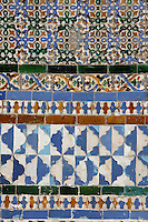 Detail of tiles, Central Patio, Casa de Pilatos (Pilate's House), Seville, Spain, pictured on December 30, 2006, in the afternoon. Pilate's House, late 15th century, was built by the Enriquez and Ribera families During the 16th century these families, who had a strong relationship with Italy,  introduced the Renaissance style to Seville. The buildings were further modified according to Romantic taste in the 19th century and now present a combination of Mudejar-Gothic, Renaissance and Romantic styles. Today the Casa de Pilatos belongs to the Fundacion Casa Ducal de Medicaneli and is the residence of the Dukes of Medicaneli. Picture by Manuel Cohen.