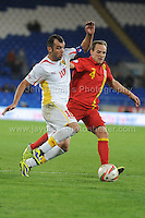 Cardiff City Stadium, Friday 11th Oct 2013. David Vaughan of Wales battles with Goran Pandev of Macedonia during the Wales v Macedonia FIFA World Cup 2014 Qualifier match at Cardiff City Stadium, Cardiff, Friday 11th Oct 2014. All images are the copyright of Jeff Thomas Photography-07837 386244-www.jaypics.photoshelter.com