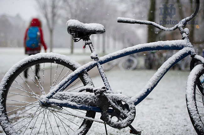 Dec. 10, 2012; A blanket of snow covers a parked bicycle in South Quad. Photo by Barbara Johnston/University of Notre Dame