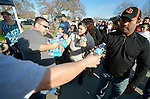 Pastor Alex Perez and other members of God's New Generation United Methodist Church pass out water to participants in a February 14 2015 march in Pasco, Washington, demanding justice for the killing of Antonio Zambrano Montes by three Pasco police officers on February 10. About 700 people participated in the rally and march.