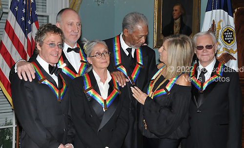Washington, DC - December 6, 2008 -- Morgan Freeman, top center, and Barbra Streisand, second from the right in the front row, converse as they and the other 2008 Kennedy Center honorees pose for the formal group photo following the Artist's Dinner at the United States Department of State in Washington, D.C. on Saturday, December 6, 2008.  Front row from left to right: Twyla Tharp, Morgan Freeman, and Barbra Streisand.  Back row from left to right: Roger Daltrey, Pete Townshend, and George Jones..Credit: Ron Sachs - Pool via CNP