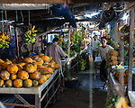 Vendors mix with shoppers amid tables of fresh fruits in the main market at Bitung, North Sulawesi, Indonesia.