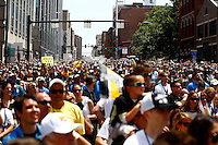 Crowds gather along Boulevard of the Allies during the Pittsburgh Penguins Stanley Cup victory parade in downtown Pittsburgh, Pennsylvania on June 15, 2016. (Photo by Jared Wickerham / DKPS)