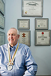 Gary Dilley, MSU graduate and Olympic silver medal winner in swimming during the 1964 Olympics in Tokyo, Japan, at his dentist office in Cary, NC, Tues., April 8, 2008.