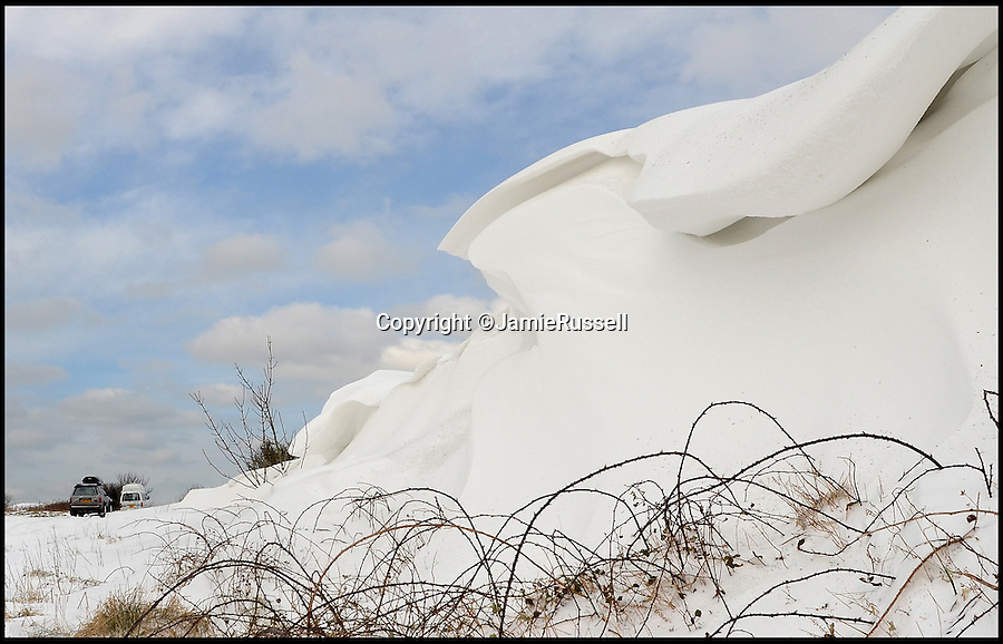 BNPS.co.uk (01202 558833)<br /> Pic: JamieRussell/BNPS<br /> <br /> ***Please Use Full Byline***<br /> <br /> A snow drift at St Catherine's.<br /> <br /> Stunning photographs have revealed a turbulent side to the normally genteel Isle of Wight.<br /> <br /> The seemingly benign south coast holiday destination has been catalogued over a stormy year by local photographer Jamie Russell, and his astonishing pictures reveal the dramatic changes in weather that roll across the UK in just 12 months.<br /> <br /> Lightning storms, ice, floods, gales and blizzards have all been captured by the intrepid photographer who frequently got up in the middle of the night to capture the climatic chaos.<br /> <br /> Looking at these pictures prospective holidaymakers could be forgiven for thinking twice about a gentle staycation on the south coast island.