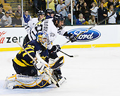 Karl Stollery (Merrimack - 7), Phil DeSimone (UNH - 39), Joe Cannata (Merrimack - 35) - The Merrimack College Warriors defeated the University of New Hampshire Wildcats 4-1 (EN) in their Hockey East Semi-Final on Friday, March 18, 2011, at TD Garden in Boston, Massachusetts.