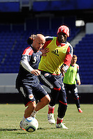 Luke Rodgers (9) of the New York Red Bulls holds off Tony Tchani (23) during practice on Media Day at Red Bull Arena in Harrison, NJ, on March 15, 2011.
