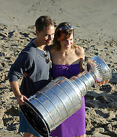 24 August 2002; Actor/Director Chad Lowe with actress wife Hilary Swank at a NHL Stanley Cup celebration party on the beach at the Pacific Ocean. .