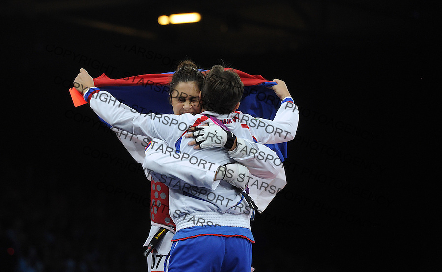 Milica Mandic of Serbia celebrates beating Anne-Caroline Graffe of France during the Women's +67kg Taekwondo Gold medal match on on Day 15 of the London 2012 Olympic Games at ExCeL on August 11, 2012 in London, England. (Photo by Srdjan Stevanovic/Starsportphoto.com).