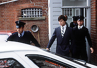 Pix: Copyright Anglia Press Agency/Archived via SWpix.com. The Bamber Killings. August 1985. Murders of Neville and June Bamber, daughter Sheila Caffell and her twin boys. Jeremy Bamber convicted of killings serving life...copyright photograph>>Anglia Press Agency>>07811 267 706>>..Jeremy Bambers, lead by police in handcuffs, at Maldon Magistrates Committal. no date..ref 0008 neg 13.